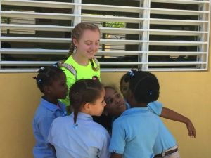 Maggie O'Leary interacts with elementary school students in the Dominican Republic on a trip with The Taft School. Her father, Waterbury Mayor Neil M. O'Leary, recently pushed the Board of Education to cancel school-sponsored trips to Peru, France and Italy. Contributed