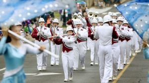 The Naugatuck High School Marching Band plays while marching down Maple Street during the Memorial Day parade in Naugatuck on Monday. Steven Valenti Republican-American