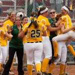 Holy Cross celebrates a triple-play during their Class S state championship game against Notre Dame-Fairfield Saturday at DeLuca Field in Stratford.   Jim Shannon Republican-American
