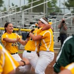 Holy Cross players Valerie Nobrega (25) Sarah Lawton (24) and Alexandra Lombardo (28) celebrate their 2-0 win over Notre Dame-Fairfield in the Class S state championship game  Saturday at DeLuca Field in Stratford.   Jim Shannon Republican-American