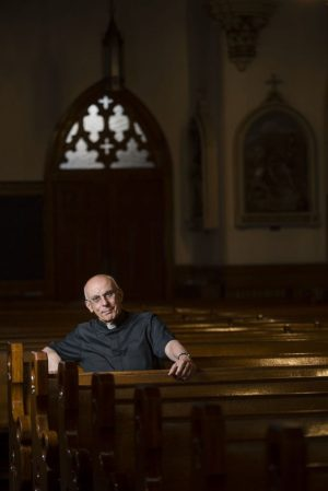 The Rev. Paul Pace has been with St. Francis Xavier Church in Waterbury for 36 years. The Waterbury-born priest has been practicing for 50 years total. Erin Covey Republican-American