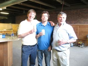 01_FEA_060116WS02 – Bruce Barrett (left) and his brother John Barrett (right) stand with their friend since childhood, Jeff Browning (middle) at the site of the three partners' BrewPort Brewing in Bridgeport, about five weeks before a planned opening in early July. Will Siss Republican-American