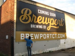 Will Siss Republican-American Co-owner and head brewer Jeff Browning of BrewPort Brewing with his new sign advertising the brewpub he plans to open in early July.
