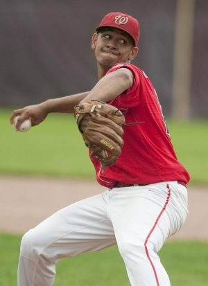 SOUTHBURY, CT--- -062015JS12 --Waterbury Post #1's Jamie Butler (22) delivers a pitch during their 2-0 win over Oakville Post 195 during the Zone 5 American Legion game Saturday at Pomperaug High School in Southbury.   Jim Shannon Republican-American