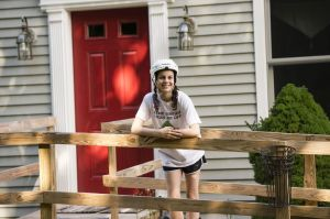 Cassidy Schod of Southbury is raising money to obtain a service dog for her seizures. She leans against a new wheelchair ramp outside her home, to be used on the days where she finds it difficult to walk. Erin Covey Republican-American