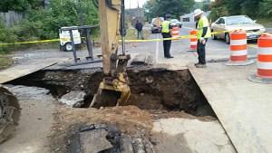 Crews work to repair a water main on East Main Street Wednesday. Michael Puffer Republican-American