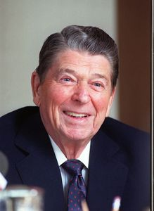 **FILE** Former President Ronald Reagan, is shown in his office in the Century City section of Los Angeles in this Feb. 5, 1990 photo. Conservative Republicans angry over an unflattering television movie about Ronald Reagan want to put his image on the dime in place of Democratic icon Franklin Delano Roosevelt. (AP Photo/Bob Galbraith, File)