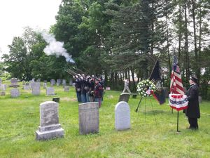 Civil War re-enactors portraying Union soldiers fire their firearms during a dedication of a headstone for Pryce Lewis, a spy who helped the Union Army during the Civil War. The late Wilber
