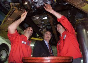 Rob Richnavsky, Shop Foreman, And Howard Leeper, Senior Tech, Look Over A
