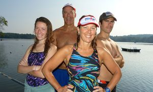 Triathlon coach Sandra Heller, foreground, has nine of her athletes competing Sunday in Ironman Lake Placid including, left to right, daughter Kristin, husband Dave, and son Trevor. Another son, Brendan, completed the Challenge Atlantic Ironman on June 29. The Hellers are seen here Tuesday at the Quassapaug Sailing Center after completing an early-morning training swim. (Joe Palladino/RA)