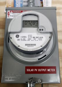 The solar PV output meter indicates how many kilowatts of power is being used at the residence of Kenny and Katie Curran of Waterbury on Friday. The Currans had solar panels installed on their home less than a year ago. Christopher Massa Republican-American