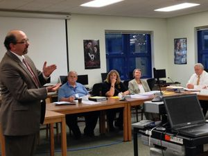 Gregory Dandio, president and CEO of Trifection Group, presents the findings of an analysis of the Region 14 school district's Internet filtration system to the Board of Education at Nonnewaug High School in Woodbury. Rick Harrison Republican-American