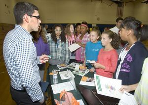 Middle school students listen to Sergio Silva, Senior Manager of Final Assembly of Fuel Cell Energy, during the Northwest Chamber Manufacturing Expo at Torrington Middle School in Torrington Friday. This expo-style event gave students an opportunity to meet local manufacturers, learn about careers in manufacturing, and participate in fun, hands-on activities.  Steven Valenti Republican-American
