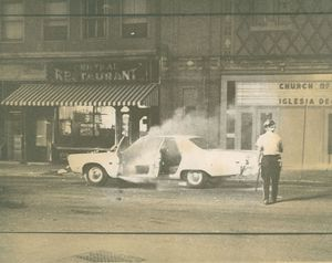 Cops and suspects fled this police cruiser after a firebomb was tossed into it during a violent uprising in North Square in 1969. Republican-American archive