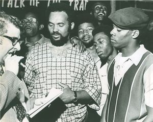 Hubert G. Williamson, center, meets with members of the Young Black Militants about patrolling the North Square after violence arose there in 1969. Republican-American archive