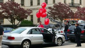 WATERBURY - Oct. 22, 2014 - 21_NEW_102214MDP02 - Andre Michaud removes balloons from his car as police prepare to tow it away Tuesday afternoon. Michaud had parked his car in front of City Hall as a demonstration against Deputy Tax Collector Karen Mulcahy, whom he claims intentionally bills him for tax debt he has already settled. Officials said he hadn't paid taxes on the car, either, and that it was towed because the registration hadn't been renewed in more than a year.
