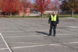 John Purdy Jr., who runs the state-mandated motorcycle rider courses offered through Naugatuck Valley Community College in Waterbury, checks out the lines in the parking lot at UConn Torrington where classes have been offered for 26 years.  Bud Wilkinson / Republican-American