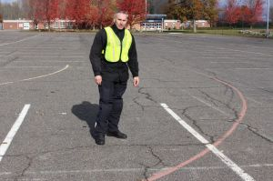John Purdy Jr., who runs the state-mandated motorcycle rider courses offered through Naugatuck Valley Community College in Waterbury, checks out the lines in the parking lot at UConn Torrington where classes have been offered for 26 years. Bud Wilkinson Republican-American