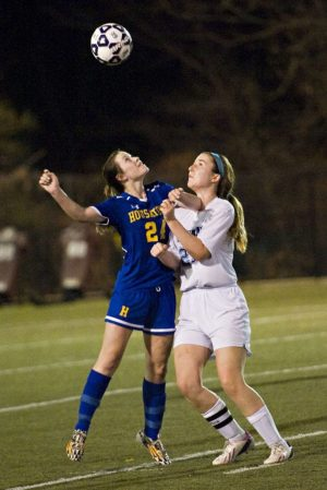 WATERBURY, CT- 11 November 2014-111114EC01-- Housatonic's Chloe Dakers and Oxford's Julia Low-Chappell jostle for the ball Tuesday night. Housatonic won the Class S semifinal game, 3-2 at Municipal Stadium. Erin Covey Republican-American