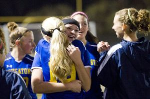 WATERBURY, CT- 11 November 2014-111114EC02-- Housatonic's Lauren Gilderdale hugs (19) Emily Geyselaers Tuesday night while the team was leading at halftime. Housatonic won the Class S semifinal game against Oxford, 3-2 at Municipal Stadium. Erin Covey Republican-American