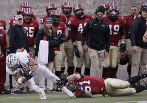 Yale running back Tyler Varga (30) is shoe-string tackled by Harvard linebacker Jacob Lindsey (51) during the second half of am NCAA college football game at Harvard Stadium Saturday, Nov. 22, 2014 in Cambridge, Mass. Harvard defeated Yale 31-24 to remain undefeated and win the Ivy League Championship. (AP Photo/Stephan Savoia)