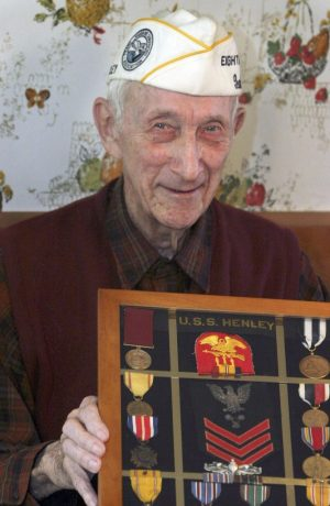 Arthur Schreier of Watertown, shown here in 2007 with medals he earned, served as the eighth district director of the Pearl Harbor Survivors Association. He died in 2011. Republican-American archive