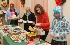 Jennifer Ryan of Goshen and her daughter, Emma, 10, were first in line for the 10th annual cookie fair at St. Thomas of Villanova Church in Goshen on Saturday. The Ryans were followed by Lisa Bauer of Litchfield and Marcia and Haworth Barker of Goshen. John McKenna Republican-American