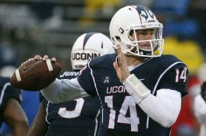 Connecticut quarterback Tim Boyle looks to pass during the fourth quarter of an NCAA college football game against Connecticut in East Hartford, Conn., Saturday, Dec. 6, 2014. Southern Methodist won 27-20. (AP Photo/Michael Dwyer)