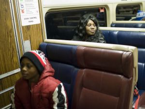 Stamford resident Amber Jenkins boards the last Metro-North train of the night Friday at the Waterbury Train Station. In front is her son, Tay Moten. They said they're thankful for the new late-night service on the Waterbury branch. Erin Covey/RA