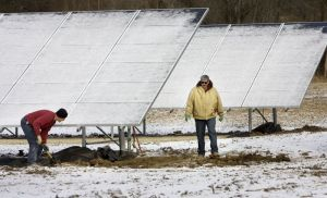 A crew from Kacerguis Excavating from Bethlehem does some site work in 2013 around solar panels installed to power Freund Farm in East Canaan. The project benefitted from a state solar incentive program that is running out of funding. Steven Valenti Republican-American