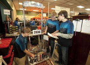 Members of the mechanical side of Team Beta, the Nonnewaug High School robotics team, from left, Charlie Doback, Ben Haggard and Nick Monterio go over strategy during the FIRST Robotics Competition, Waterbury District Event, in February at Wilby High School in Waterbury.  Republican-American Archive
