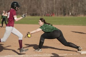 SOUTHBURY, CT-16 April 2015-041615EC06- Pomperaug's Annalee Yacavone is safe at first after New Milford's Ally Helmus drops the ball Thursday in Southbury. Erin Covey Republican-American