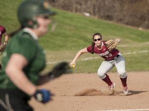 SOUTHBURY, CT-16 April 2015-041615EC02- Pomperaug's third baseman Annabella Pastorok throws to first as New Milford's Avery Kelly makes a base hit Thursday in Southbury. Kelly was safe. Erin Covey Republican-American