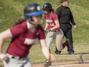 SOUTHBURY, CT-16 April 2015-041615EC05- Pomperaug's Rebecca Meyer runs home after a base hit by teammate Laurel Williams (seen in photo) Thursday. The Panthers played New Milford in Southbury. Erin Covey Republican-American