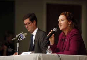 U.S. Rep. Elizabeth H. Esty answers a question during a Fifth Congressional District debate at the Portuguese Cultural Center in Danbury on Thursday night. At left is her Republican challenger Clay Cope. The event was hosted by the League of Women Voters of Northern Fairfield County, the Danbury News-Times and the League of Women Voters of Litchfield County. Christopher Massa Republican-American