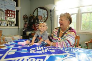 Audrey Blondin, a Torrington attorney and 30th District State Central Committee member, shows off the Hillary Clinton baby T-shirt she bought for her daughter, Lily Rose Shea, as well the Clinton-Kaine lawn signs. Blondin spent $270 to buy about 57 signs to compete with the high number of Trump signs in Litchfield County. Bruno Matarazzo Jr. Republican-American