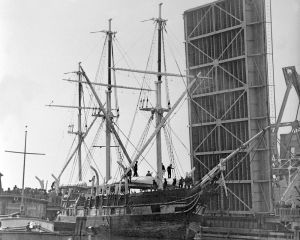 In this Nov. 8, 1941 photo released by Mystic Seaport, the whaling ship Charles W. Morgan passes under the Mystic drawbridge in Mystic, Conn. The worldís last surviving wooden whaling ship is nearing completion of a $7 million restoration and will be launched on July 21, 2013, the 172nd anniversary of the vessel's original launch in New Bedford, Mass. (AP Photo/Mystic Seaport)