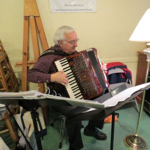 Accordionist Paul Ramunni performs during the Community Thanksgiving Dinner in Canaan on Thursday. Ruth Epstein Republican-American