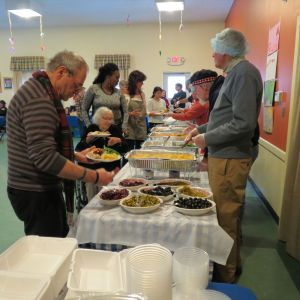 Guests are served a sumptuous meal at Thursday's Community Thanksgiving Dinner at the Pilgrim House in Canaan. Ruth Epstein Republican-American