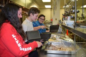 Culinary students at Oliver Wolcott Technical School in Torrington make to-go containers for community members during the school's 34th annual community Thanksgiving dinner on Thursday. Jacqueline Stoughton/Republican-American