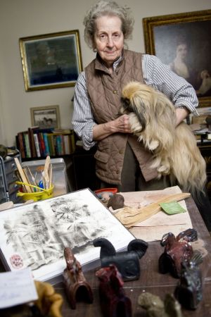 WASHINGTON, CT - 01 DECEMBER 2009 -120109JT05-- Louise King, posing for a photo here with her dog Toad at her Washington home where she builds her mud ponies and soot monoprints, will have her work on view at the Gunn Memorial Library in Washington beginning Dec. 12. Josalee Thrift Republican-American