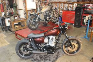 The 1980 Yamaha XS650 that Eric Pleil has completed, foreground, and the 1985 Honda CB450 that he's working on for a customer. Bud Wilkinson Republican-American