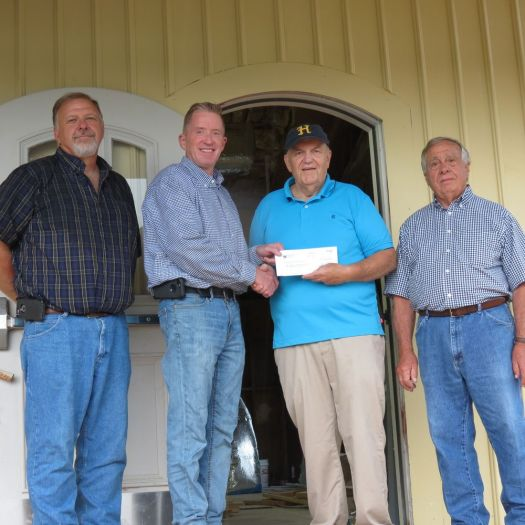 Specialty Minerals/Minteq donates $15,000 toward the renovation of the Canaan Union Depot. Presenting the check to Connecticut Railroad Historical Association members Douglas E. Humes Jr., first selectman, second from right, and Robert Gandolfo, are Rick MacDowell, engineering manager, left, and Jay Sams, plant manager. Ruth Epstein Republican-American