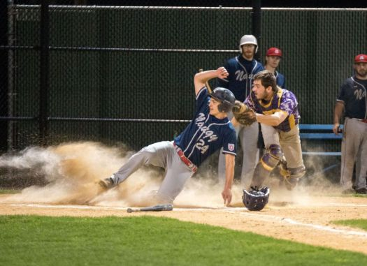 Ryan Russell, left, of the Naugy Dogs, slides into home plate ahead of a tag by Tri-Town catcher Bobby Smith in the fourth inning of the Tri-State League World Series game Wednesday at Municipal Stadium in Waterbury. (Devin Leith-Yessian / Republican-American)