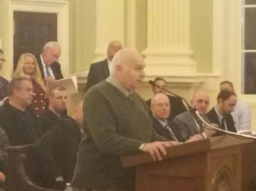 Lawrence V. De Pillo Jr. speaks to the Board of Aldermen in February, opposing a proposed $29 million increase to the cost of building a new public works facility and developing a manufacturing park in the former Chase Brass site off Thomaston Avenue.