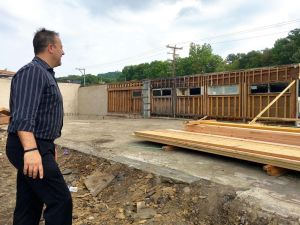 The Rev. James Lilley of First Assembly of God Church looks over the renovation of part of the Waterville Lumber Yard into a day care center. The church plans a complex that will also include a Christian bookstore/coffeehouse and food pantry on Thomaston Avenue in Waterbury.