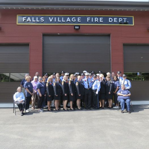 Members of the Falls Village Fire Department, ambulance squad and Ladies Auxiliary pose in front of the town's new Emergency Services Center during Sunday's open house and dedication of the facility. Ruth Epstein Republican-American