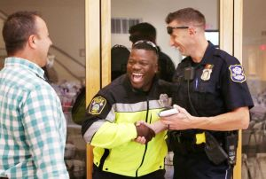 Pastor James Lilley, left, shares moment Monday with officers Otis Baskins, Naugatuck Police, and Guy Tiso, Waterbury Police, during a first responder appreciation event at First Assembly of God in Waterbury. Steven Valenti Republican-American