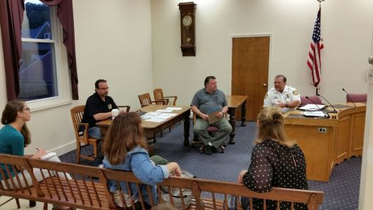 Winsted Police Chief William Fitzgerald, right, addresses the Opiate Task Force in Winsted at its first meeting on Wednesday night. Selectman Todd Arcelaschi, center, started the task force. Contributed
