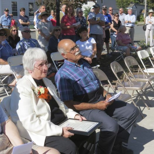 Patricia A. Mechare and her husband Curt listen as speakers commend her for her years of public service during a ceremony Saturday.